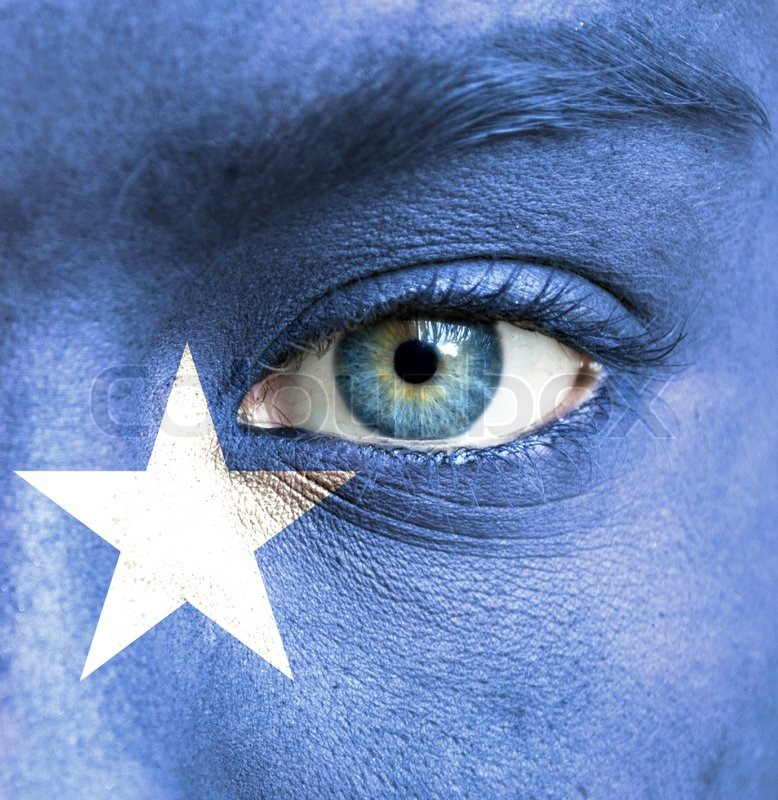 Human face painted with flag of Somalia  Stock Photo  Colourbox