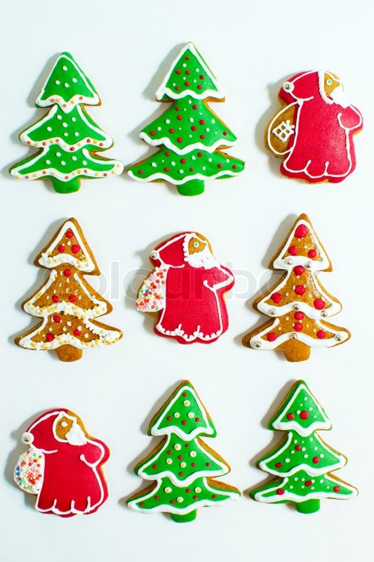 christmas gingerbread cookie made in the shape of a christmas trees and santa claus isolated on a white background stock photo colourbox - Gingerbread Christmas Tree
