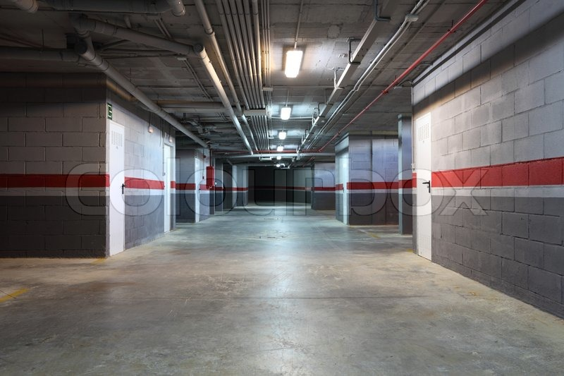 Empty underground garage in a residential building   Stock Photo   Colourbox