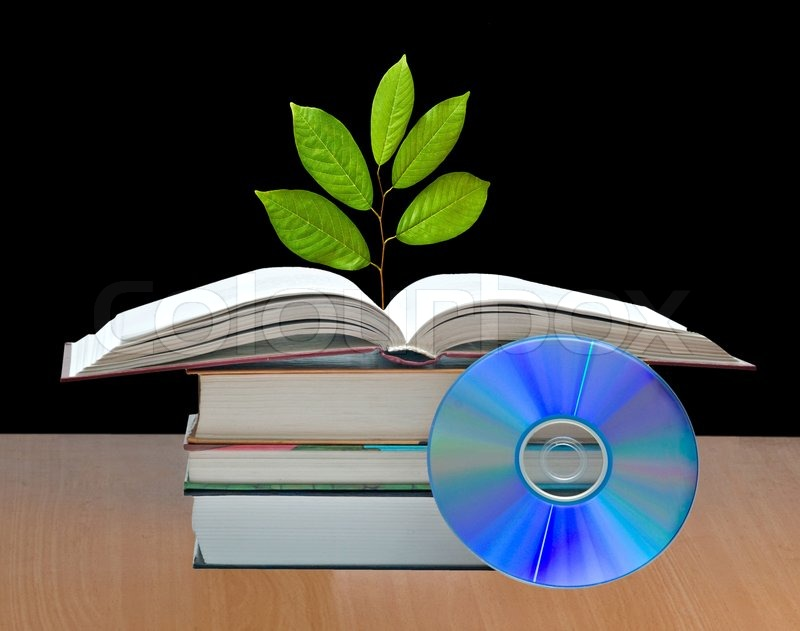 Tree growing from open book, stock photo