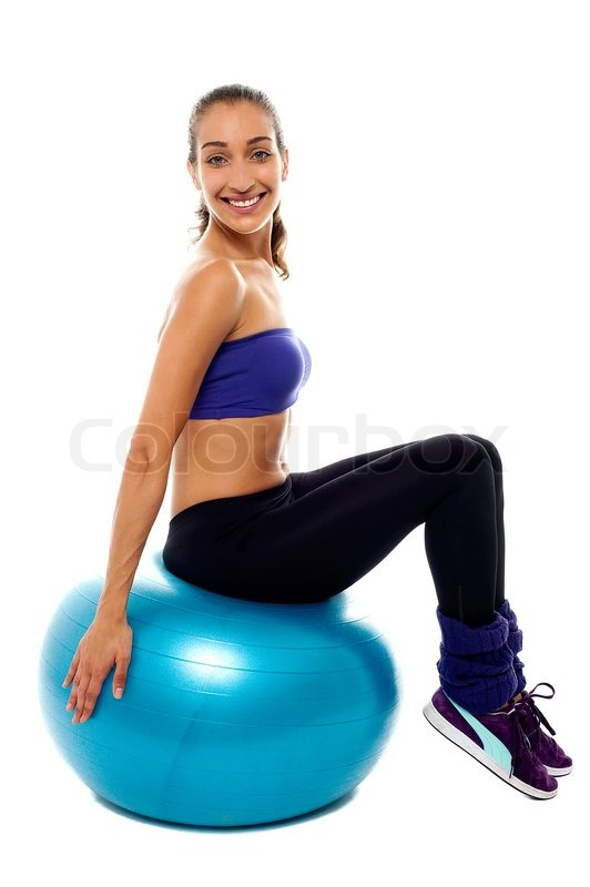 Pretty Lady Sitting On Big Blue Exercise Ball Stock