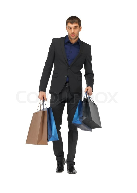 Handsome man in suit with shopping bags | Stock Photo | Colourbox