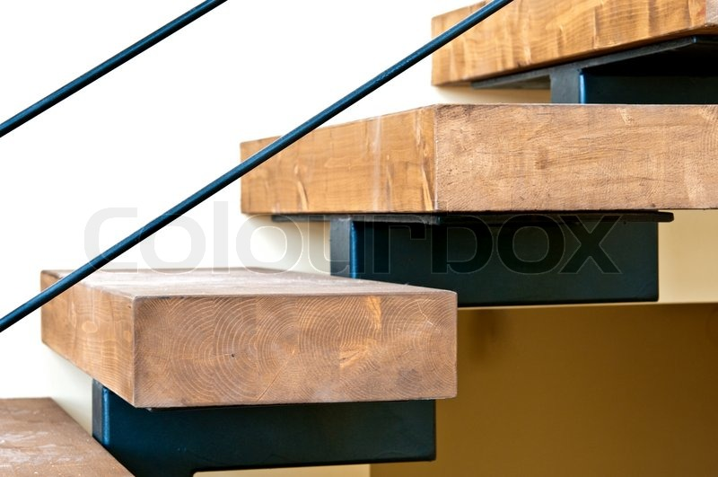 Wooden stairs and solid laminated wood mounted on a metal ...