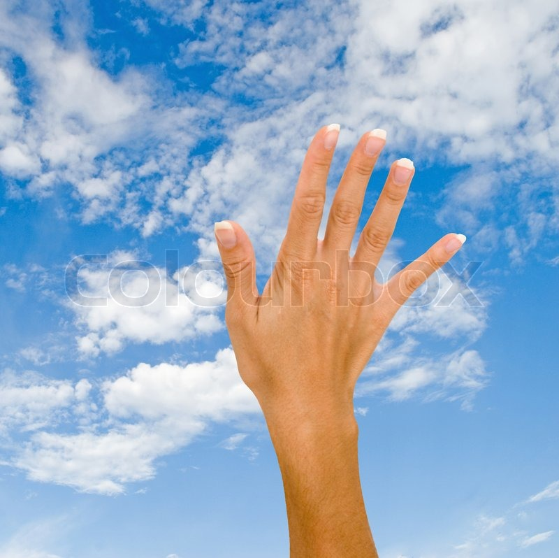 Hand on sky background, stock photo