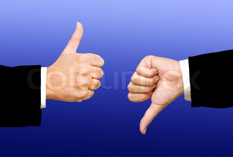 Hands showing thumb up and thumb down, stock photo