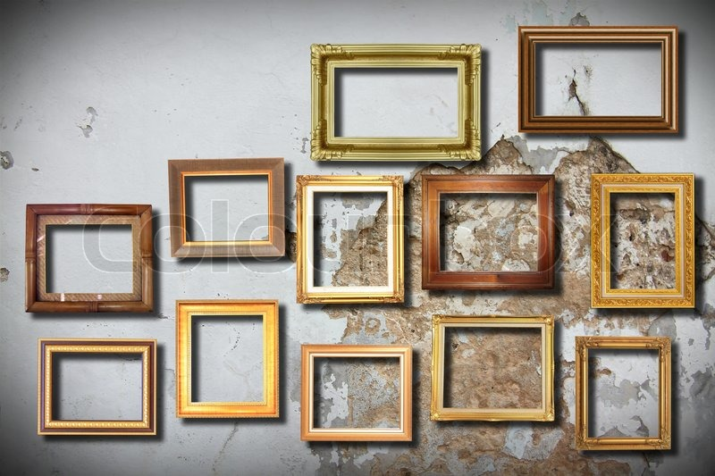 Golden frame on old wall | Stock Photo | Colourbox