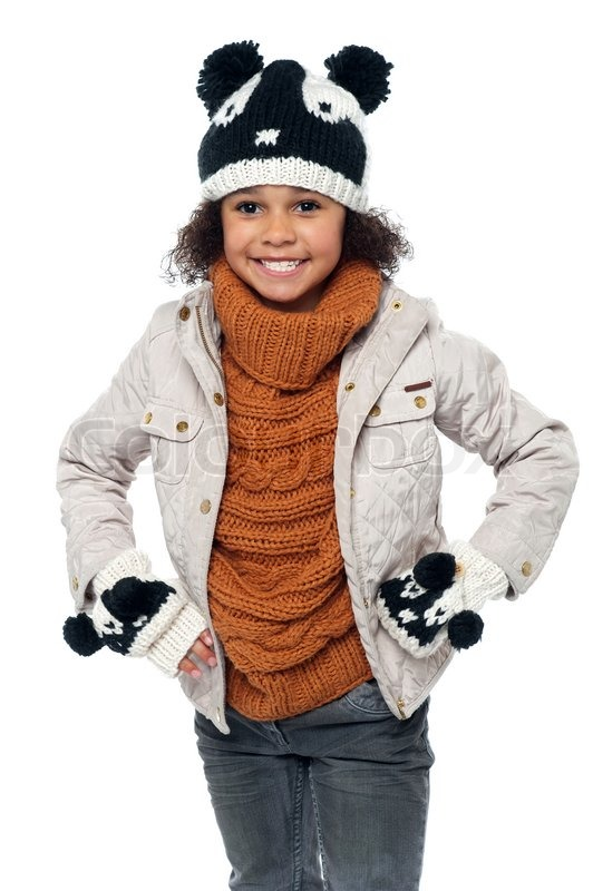 cute little girl in fashionable warm winter clothes