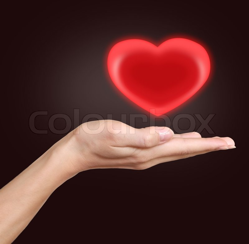 Woman Hand Holding Heart Love And Heath Symbol Isolated On Dark