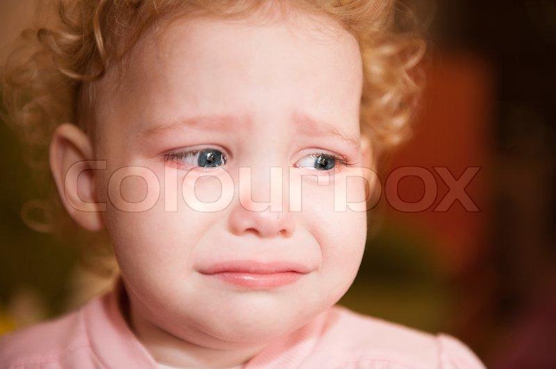 Crying baby face close...