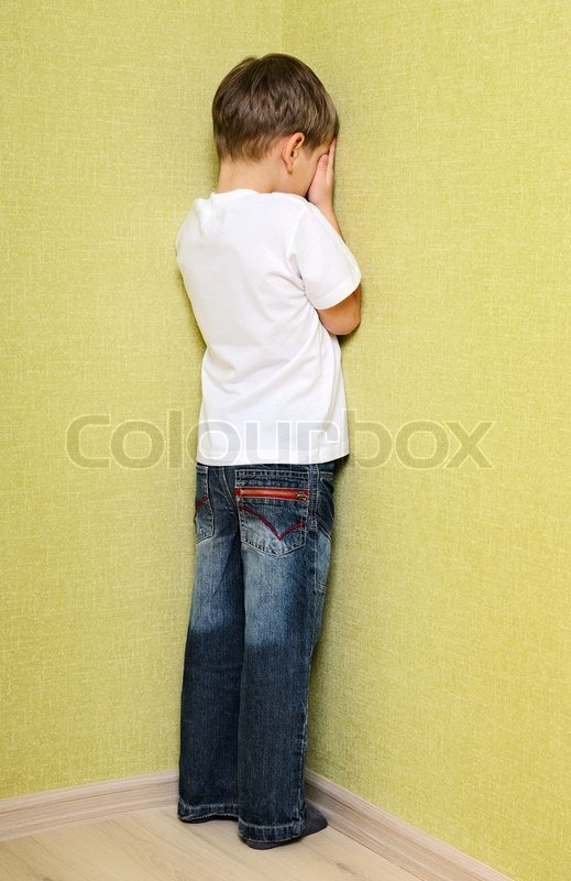 little child boy wall corner punishment standing stock