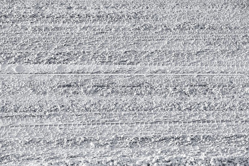 background texture of urban road covered with ice and wet snow stock