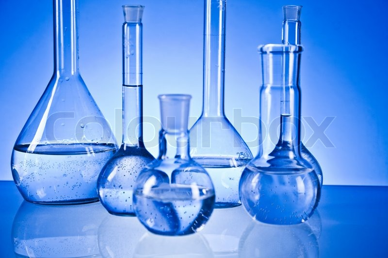 Stock image of laboratory glassware isolated on blue