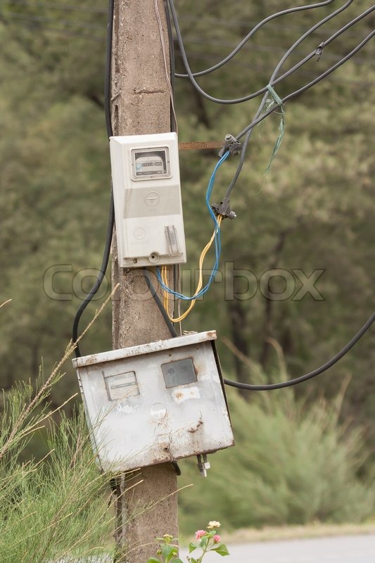 Concrete Meter Pole : Cabinet with electrical meter on a concrete pole stock
