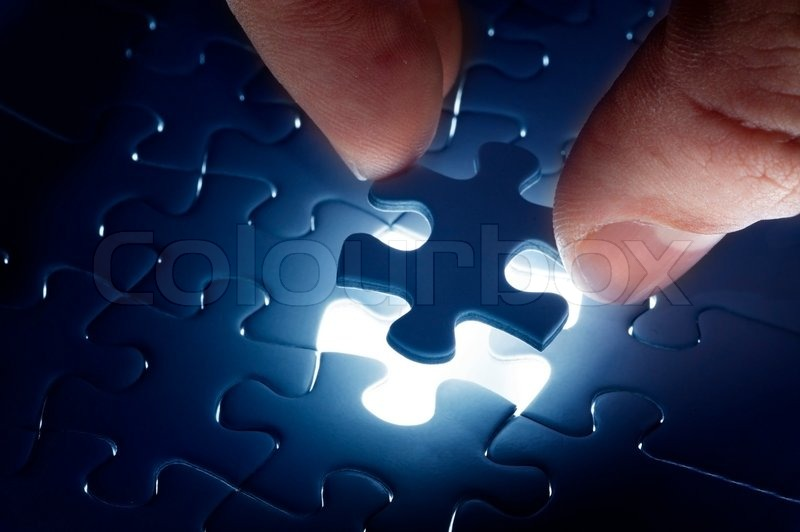 Missing jigsaw puzzle piece with light glow, business concept for completing the final puzzle piece, stock photo