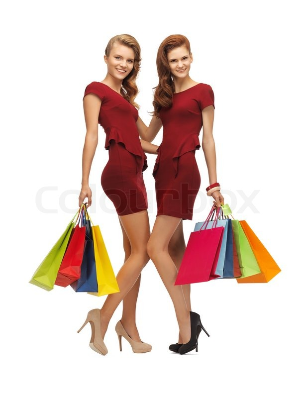 Two teenage girls with shopping bags | Stock Photo | Colourbox