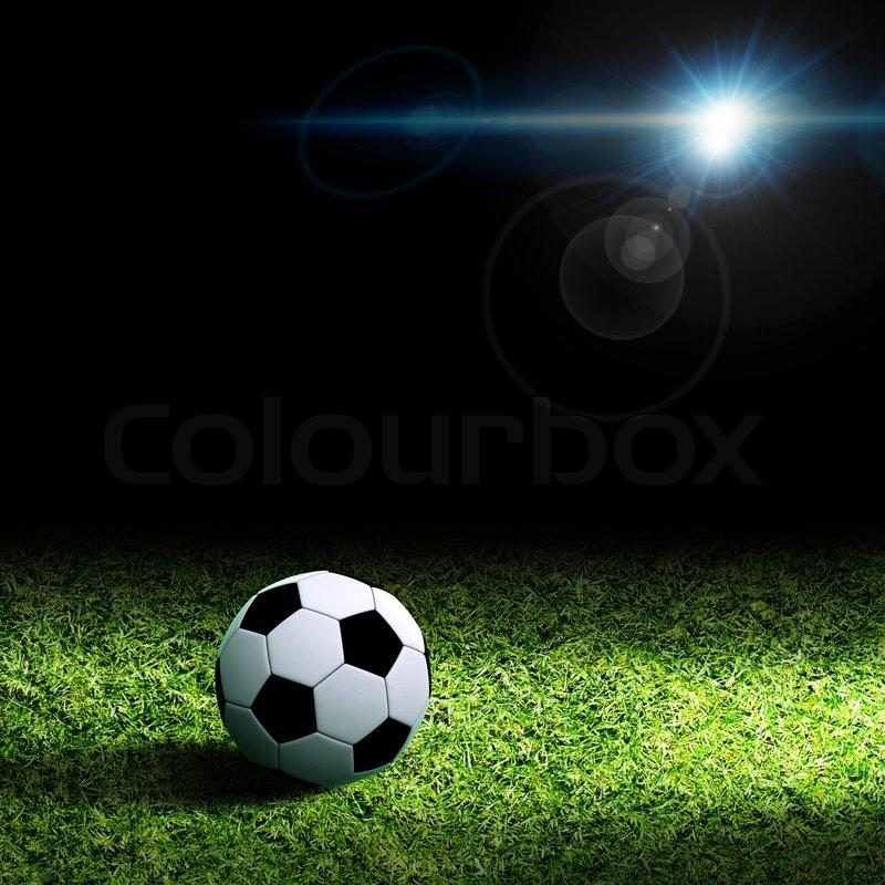 Soccer ball on grass, stock photo