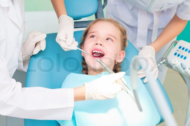 Girl visiting dentists, visit the dentist | Stock Photo | Colourbox