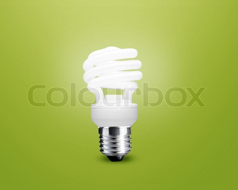 Glowing Light bulb idea on green background, stock photo