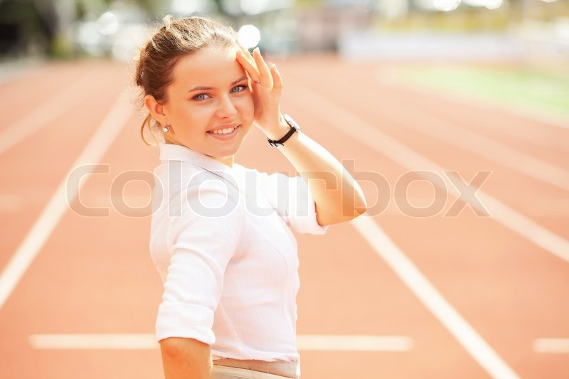 Business woman sport manager at athletic stadium, stock photo