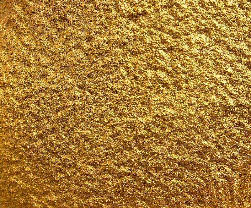 Golden Stone Wall Texture For Background Stock Photo