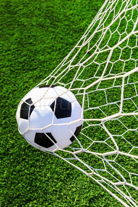 Soccer ball in goal net  8ecf1bab9