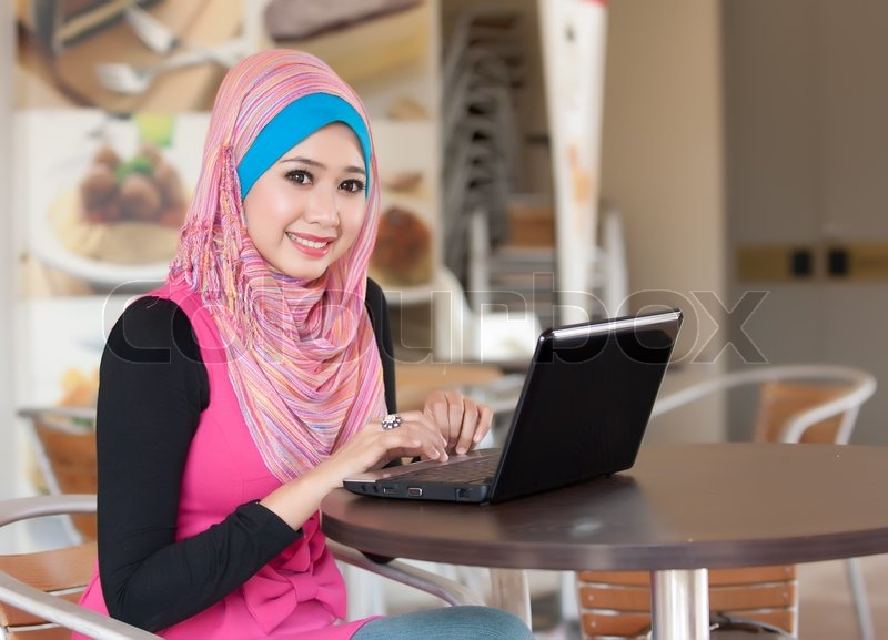 Portrait of the pretty muslim women with the laptop ...