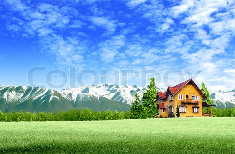 House and moutain on green field landscape with blue sky, stock photo