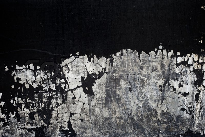 Old black paint texture peeling off concrete wall background Stock