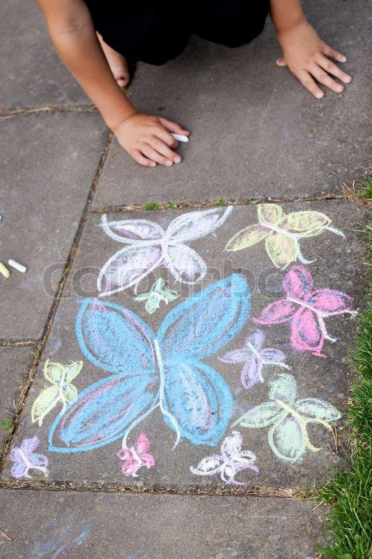 Chalk drawing of butterflies on sidewalk, stock photo