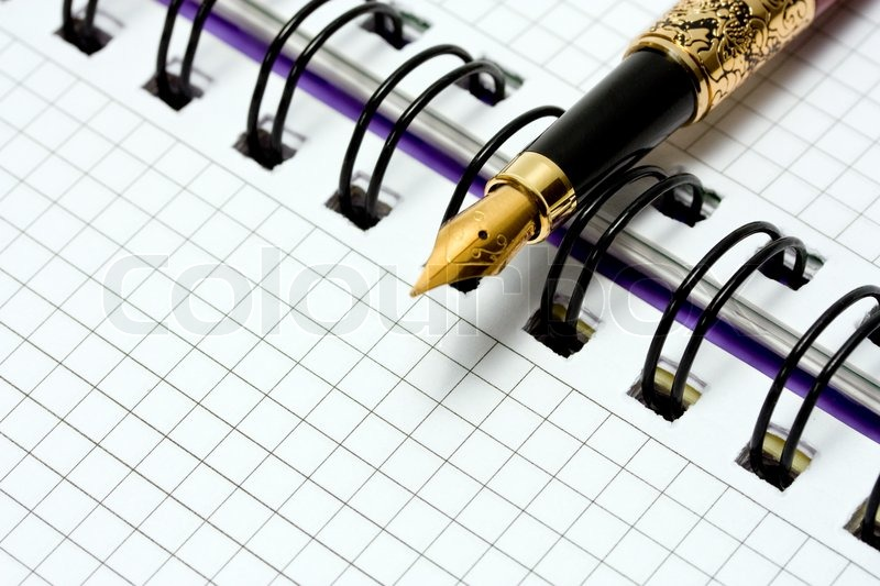Fountain Pen on notebook, stock photo