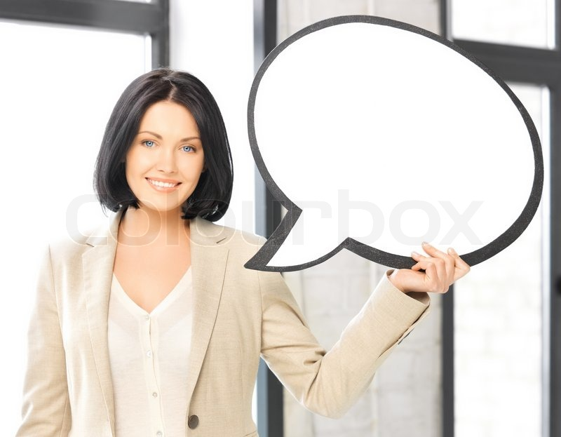Smiling businesswoman with blank text bubble, stock photo