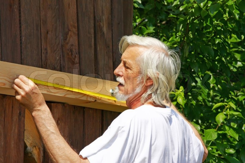Attractive old man measure distance do it yourself stock photo attractive old man measure distance do it yourself stock photo colourbox solutioingenieria Image collections