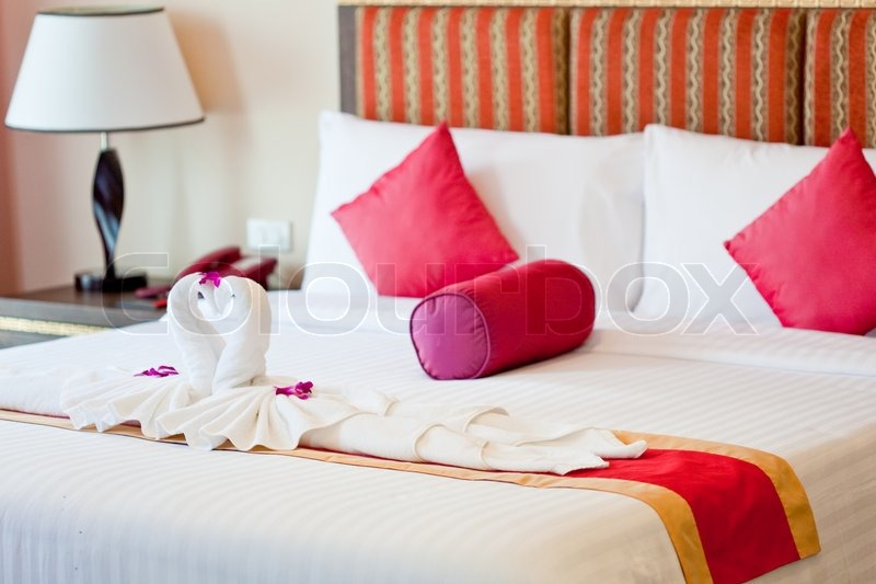 Honeymoon Bed Suite Decorated With Flowers And Swan Towels