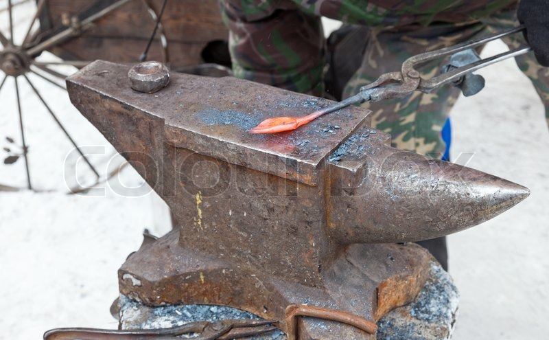blacksmith anvil and hammer. blacksmith working metal with hammer and anvil | stock photo colourbox