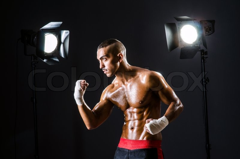 Boxer with studio lights in sports concept, stock photo