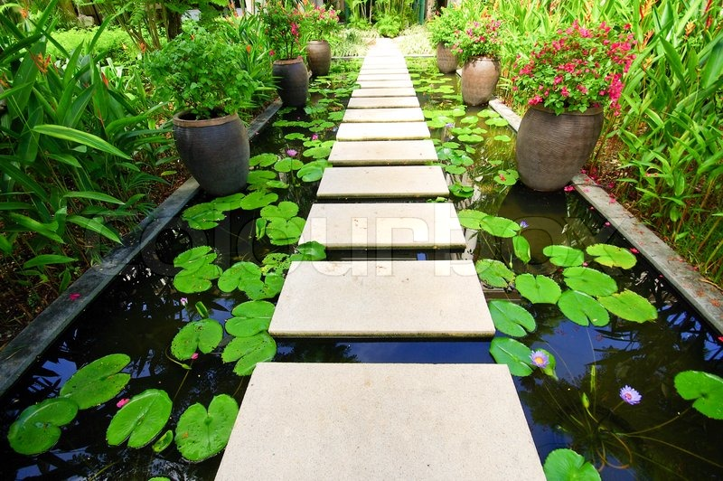 Over The Garden Walk: The Stone Block Walk Path In The Garden On Water