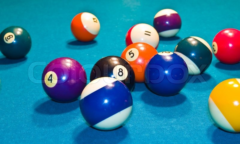 billiards balls with motion on a green pool table stock photo rh colourbox com pool table balls set up pool table balls vintage