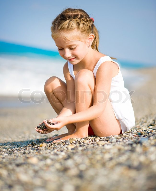 Little girl on the beach | Stock Photo | Colourbox