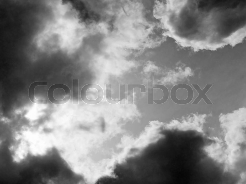 White and gray clouds in a pale sky, stock photo
