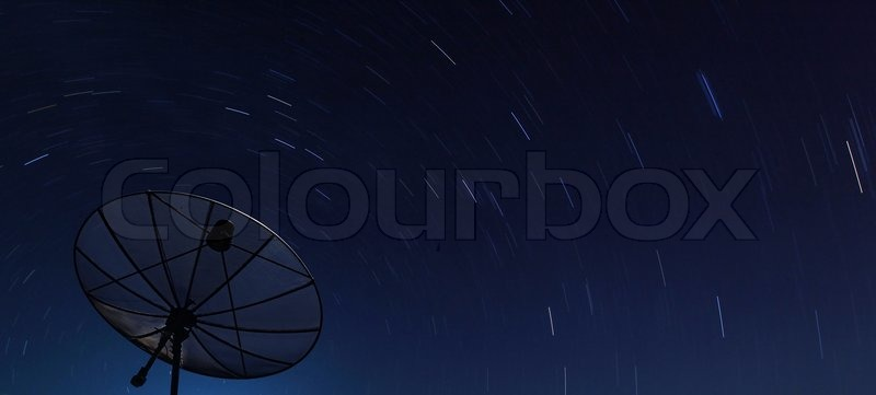 Conceptual of Big Black satellite over spiral star at night, stock photo