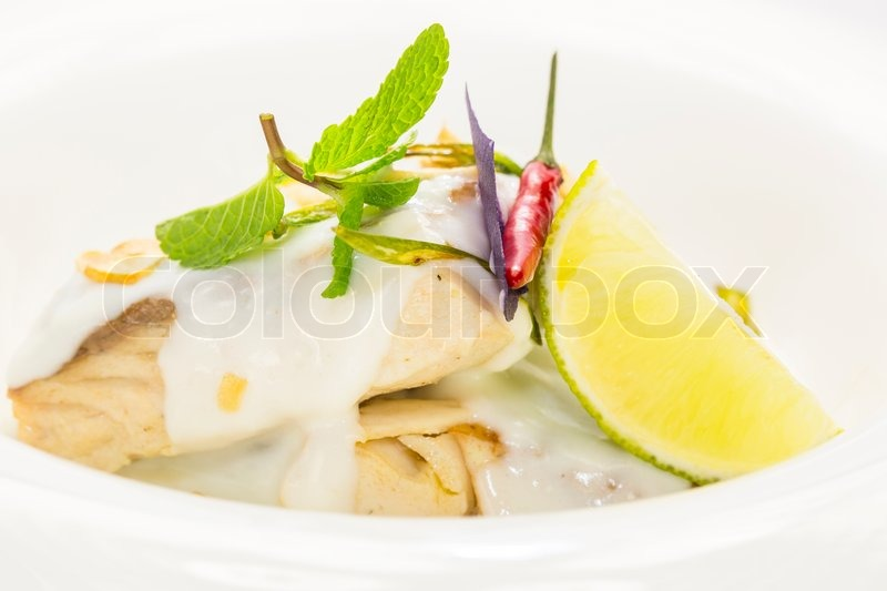 Baked fish in cream sauce with lemon stock photo colourbox for Lemon cream sauce for fish