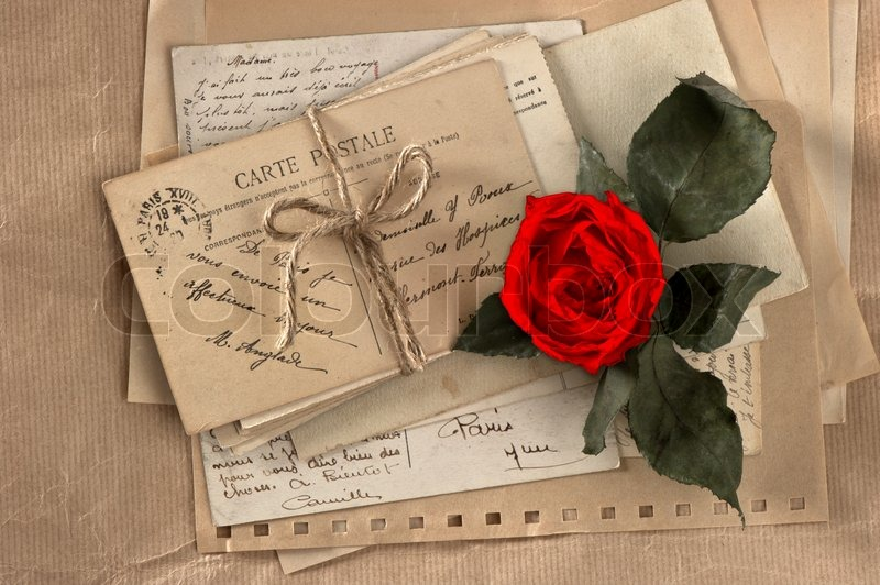 dry red rose and old love letters stock photo colourbox