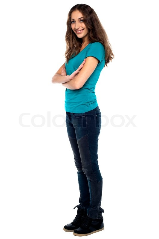 stylish woman standing sideways with arms crossed stock photo