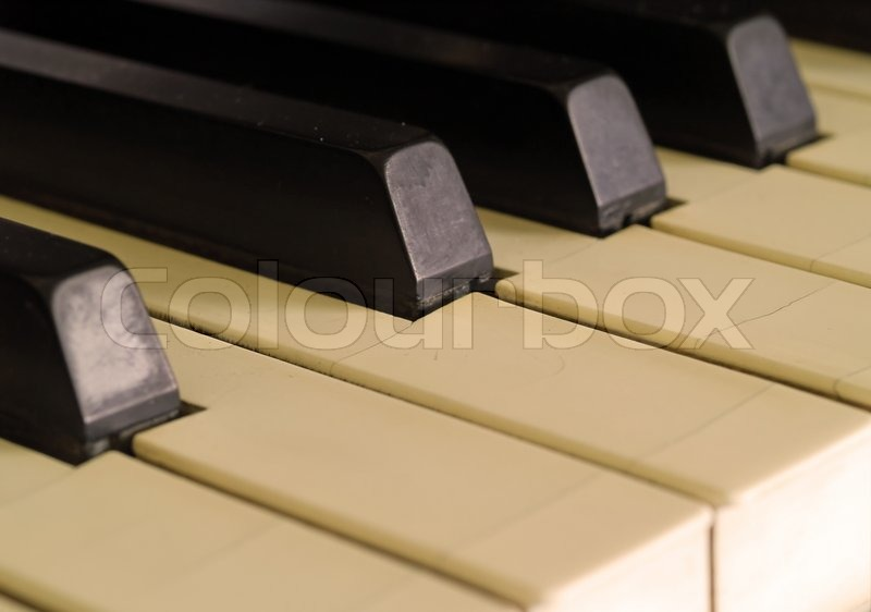 Piano keys of a very well loved and often played piano in Sepia, stock photo