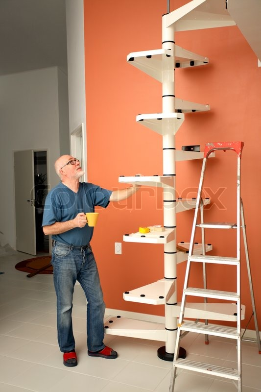 Senior Handyman Enjoying Cup Of Coffee While Assembling Diy Spiral Stairs |  Stock Photo | Colourbox