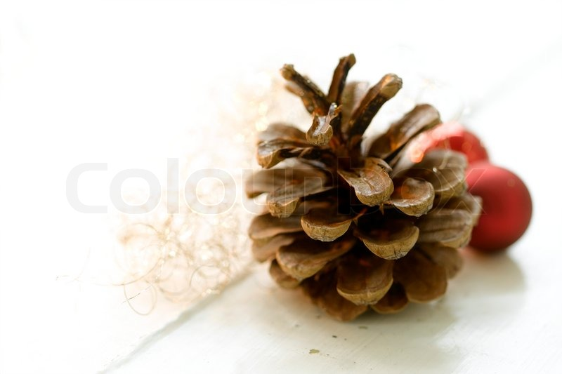 Stock image of 'Close up image of pine cone and baubles used for Christmas decoration'