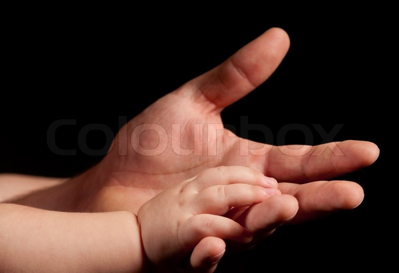 The hands of father and child, stock photo
