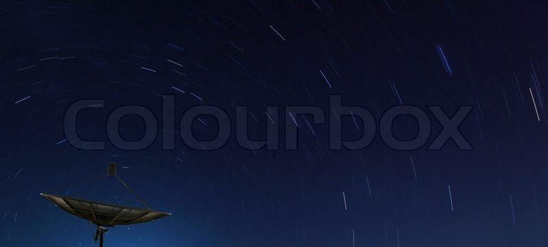 Conceptual of Big Black satellite over spiral star, stock photo