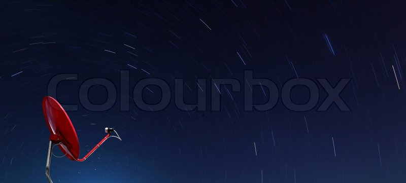 Conceptual of Red satellite over spiral star at night, stock photo