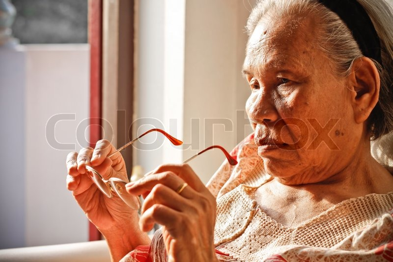 Stock image of 'Elderly woman with eyeglasses'
